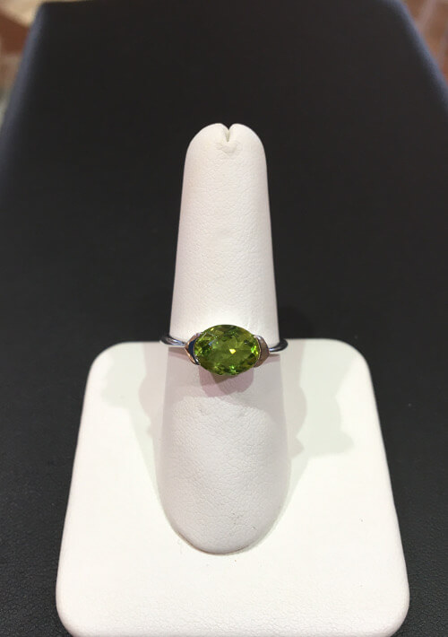 oval peridot ring set east to west