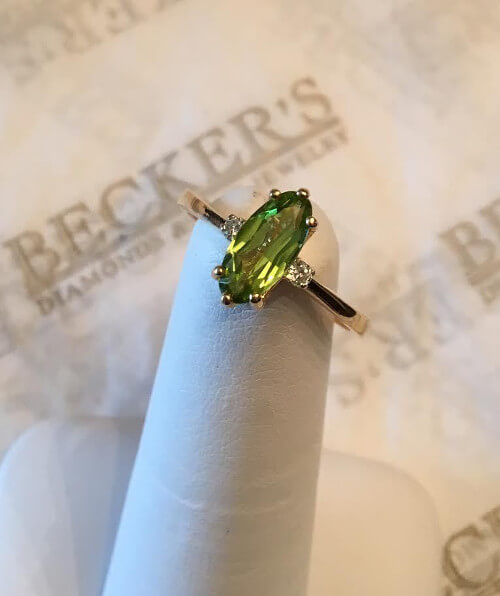 oval peridot and diamond ring