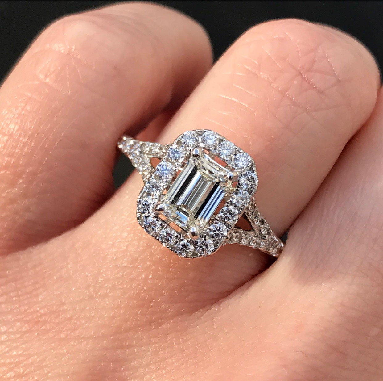 Emerald cut halo split shank ring