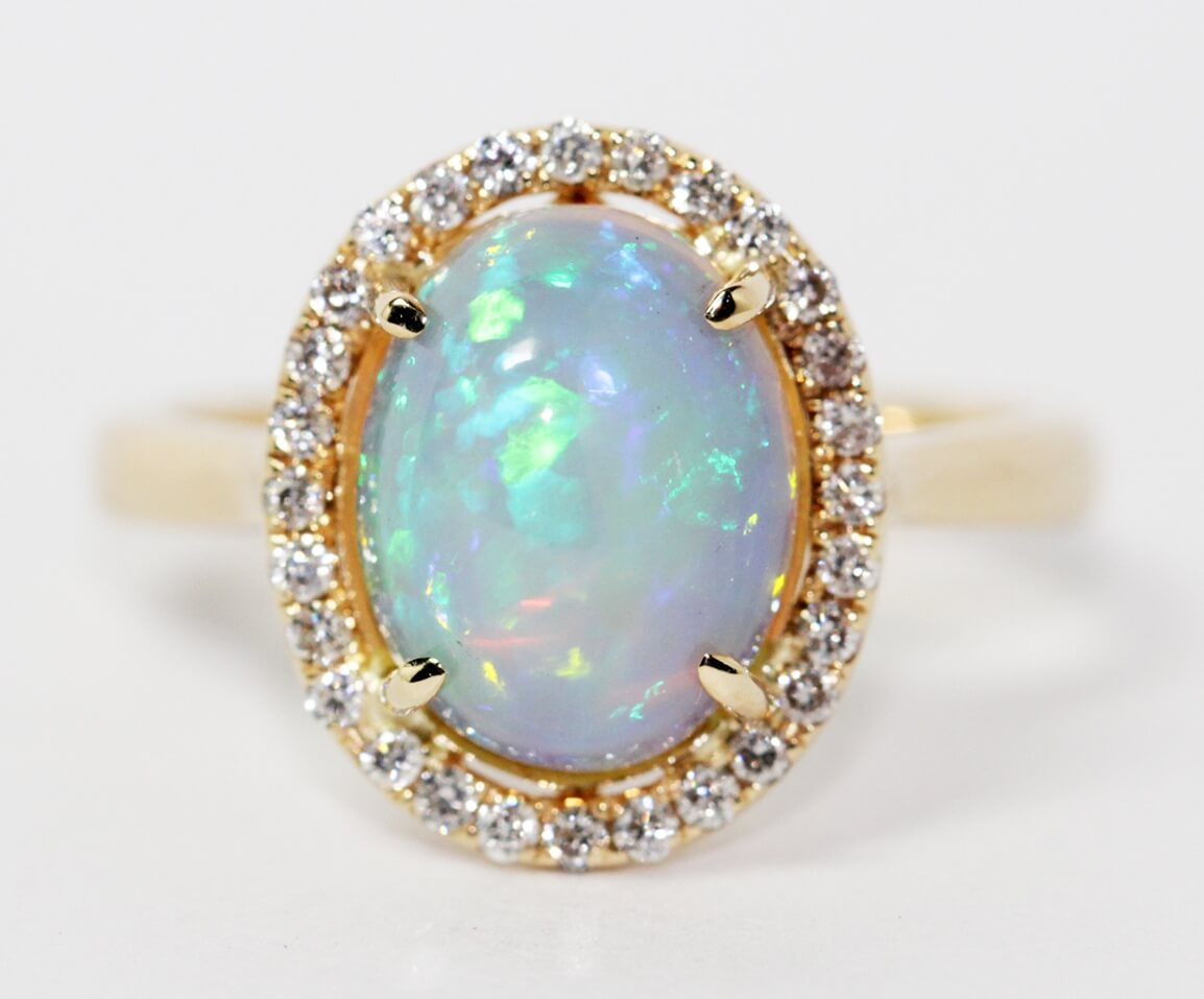 Opal diamond halo ring