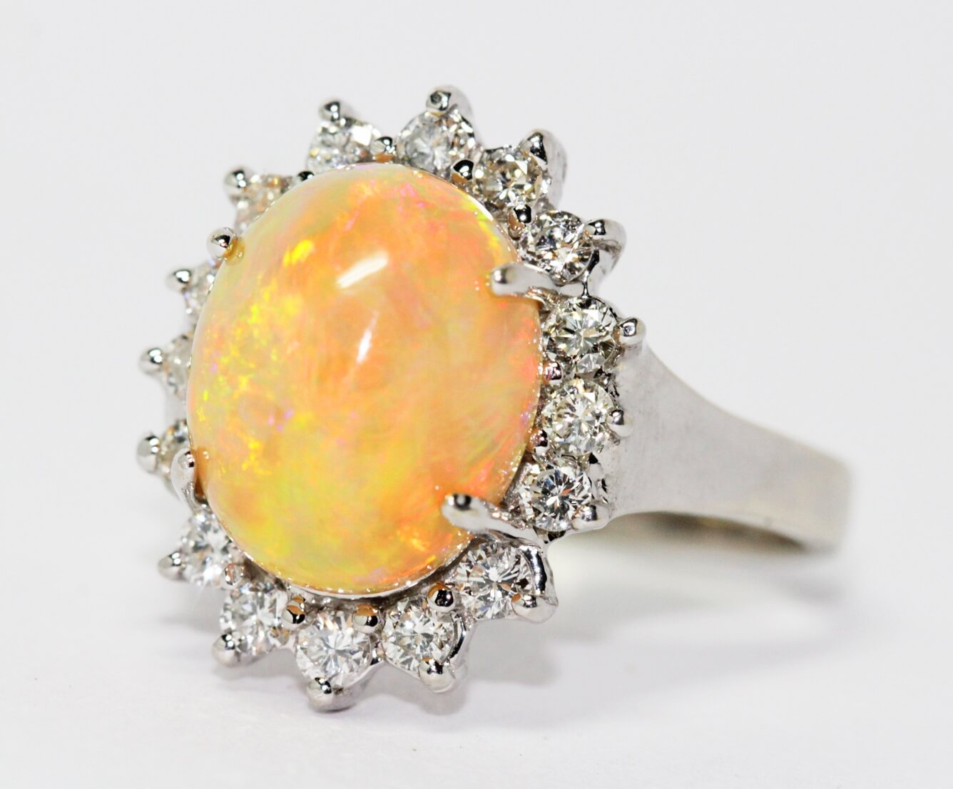 Orange opal diamond halo ring